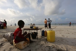 Somali kid walk long side liido beach  early morning on June 6, 2014 Somali schools are closed during the Friday copyright feisal omar