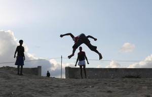 Somali man playing summersault at liido beach Mogadishu Somalia on August 10, 2015 photography by Feisal Omar