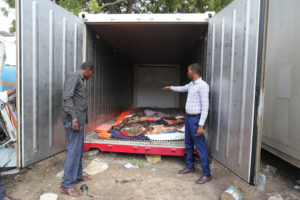 Relatives look The dead bodies of the farmers lying inside a truck container designed to carry lobsters after hospitals refused mortuary space due to pressure from the government that wants bodies buried before investigation. In Mogadishu on August 27, 2017 REUTERS/ FEISAL OMAR
