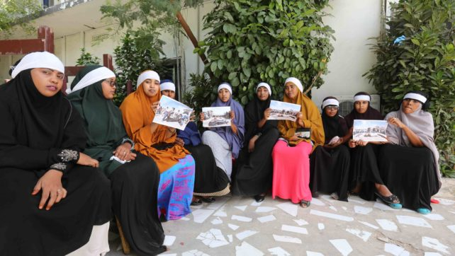 Several Somali women sit in Mogadishu's diplomatic hotel  with white  cloth  tied round their heads   to mark the death of their family who were killed by US and Somali forces in Barire village farms